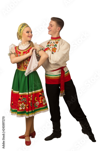 Fotografie, Obraz  Beautiful caucasian cuple dancing in Russian folk costumes isolated on white