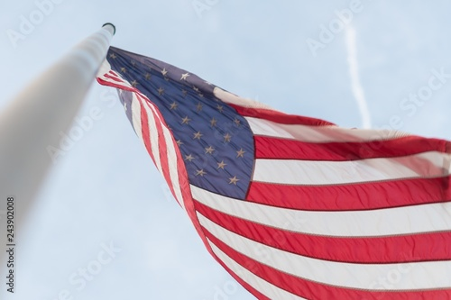 Photo  American Flag swinging in the wInd