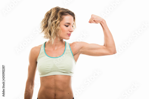 Stampa su Tela Portrait of fit girl showing her biceps