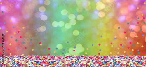 Fotobehang Carnaval Colorful confetti in front of colorful background with bokeh for carnival
