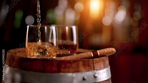 Whiskey drinks placed on wooden keg Canvas Print