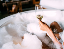 Young Woman Relaxing In The Hydro Massage Bath Covered In Foam