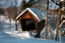 Wind Blowing Snow Around Covered Bridge In New England