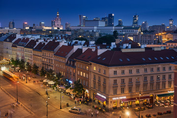 FototapetaBeautiful panoramic night view over the roofs of the Old Town to the Center of Warsaw, the Palace of culture and science (PKiN), modern skyscrapers and Krakowskie Przedmiescie street at summer warm ni