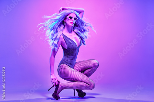 Fotografie, Obraz  Disco Party Doll girl with Purple hairstyle dance