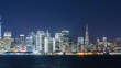 Timelapse of Downtown San Francisco Skyline over Bay at Night -Zoom Out-