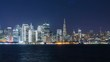 Timelapse of Downtown San Francisco Skyline over Bay at Night -Pan Left-