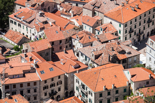 Fotografie, Obraz  Top view of the red-tiled roofs in the old town of Kotor, Montenegro