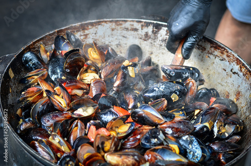Seafood mussels cooked outdoors. Toned image.