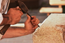 Closeup Of A Carpenter Hands Working With A Chisel And Carving Tools On Wooden