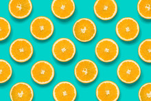 Fruit Pattern Of Orange Slices On Blue Background. Flat Lay, Top View. Food Background.