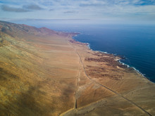 An Aerial View Of Paposo Town And The Cliffs In Front Of The Coastline. The Camanchaca (Humidity From The Sea) Creates Morning Clouds At Atacama Desert Coast Area, An Amazing Arid And Dry Landscape