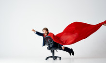 Business Man The Hero In A Red Raincoat Rolls On A Chair On An Isolated Background