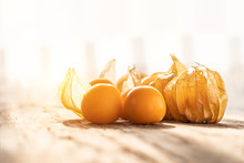 Cape Gooseberry On Wood In Beautiful Light