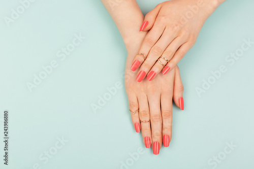 Foto op Canvas Spa Woman hands on blue background