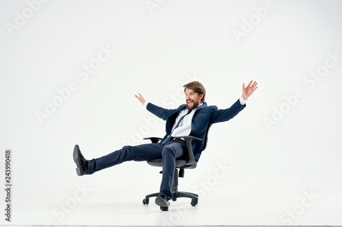 Valokuva  business man riding his chair on an isolated background