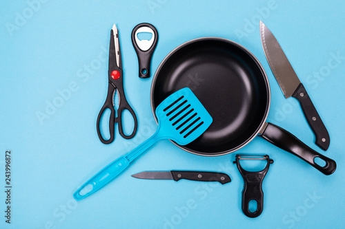 Close up picture of group of kitchen utensils with copyspace on blue background Canvas Print