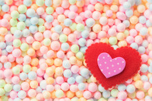 Valentine, Wedding And Love Background Concept. Pink And Ted Hearts On Colorful Small Foam Ball Pattern In Box With Free Copy Space. Picture For Add Text Message. Backdrop For Design Art Work.