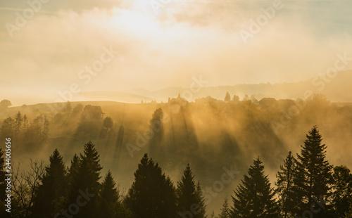 Foto auf Leinwand Beige foggy sunrise in mountains