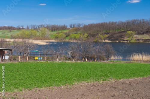 Fotografering  Spring landscape with Suha Sura riverside in Vasylivka village near Dnepr city,