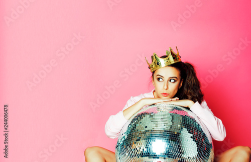 young cute party girl like barbie on pink background with disco ball and crown Canvas Print