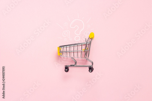 Photo  Shopping trolley from the supermarket on an isolated pink background