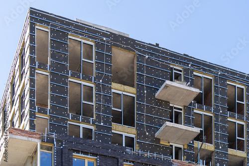 Unfinished building standing against blue peaceful sky Fotobehang