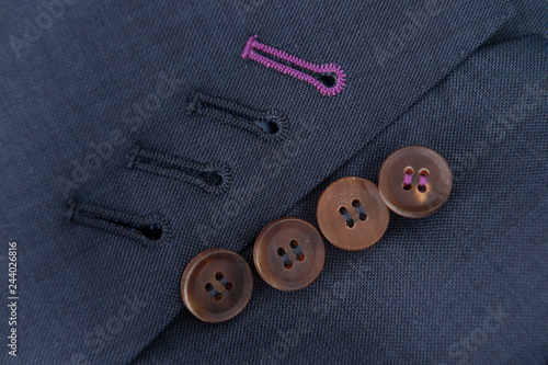 Fotografie, Obraz  Detalle costura textil, botones chaqueta