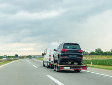 Car Carrier Trailer With New Car On Highway