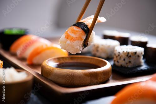 Deurstickers Sushi bar Chopstick with nigiri sushi piece