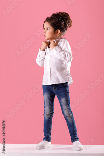 Valokuva  angry little child girl in white shirt with hairstyle