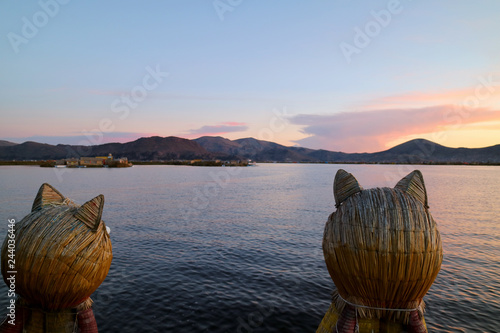 Poster Zuid-Amerika land Stunning View of Lake Titicaca after Sunset as Seen from the Famous Totora Reed Boat with a Pair of Puma Shaped Prows, Puno, Peru