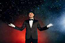 Professional Occupation. Showman In Suit Gloves And Hat Standing Isolated On Wall Starting Show Smiling Happy