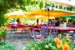 canvas print picture - Sehr schöner Bayerischer Biergarten auf dem Oktoberfest als Hintergrund