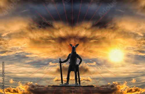 Photo  Mythical figure of Old Norse god Odin with sword against backdrop of a dramatic