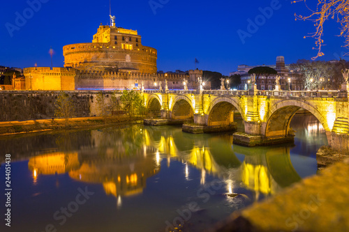 Photo Stands Rome Saint Angel Castle over the Tiber river in Rome at night, Italy