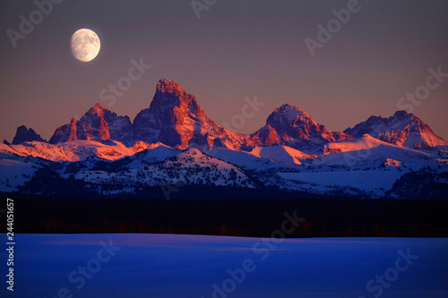 Obraz na plátne Sunset Light Alpen Glow on Tetons Teton Mountains wtih Moon Rising