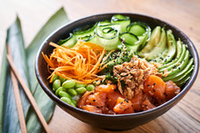 Poke Bowl On Wooden Background