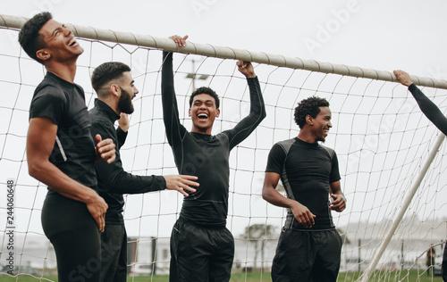 Fotografia, Obraz  Group of footballers standing near the goalpost