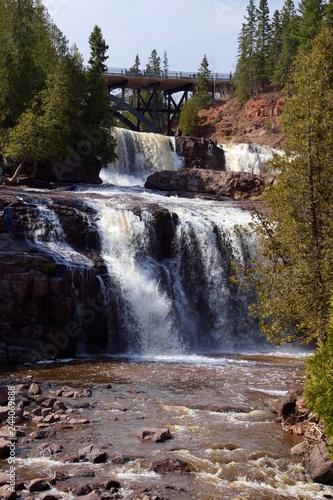Waterfall in front of bridge