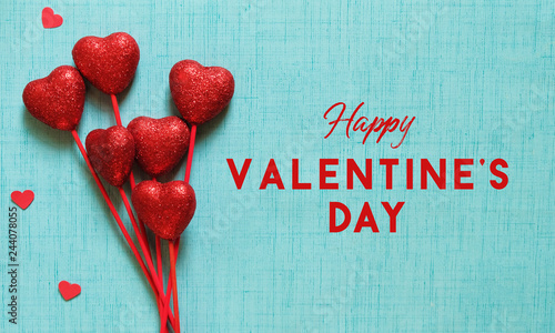 Happy Valentine's Day graphic on blue background with holiday text.  Red hearts arranged for banner full of love.