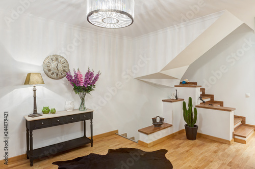 Stylish antechamber with wooden stairs to the second floor Wallpaper Mural