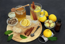 Healing Flu And Cold Remedy Ingredients With Echinacea Herb, Eucalyptus Oil, Fresh Ginger, Lemon Fruit, Cinnamon Sticks And Honey With Natural Medicinal Drink On Slate Background.