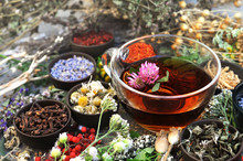 Healthy Herbal Tea On Medicinal Flowers And Herbs Background, Selective Focus, Toned