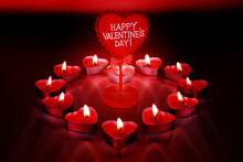 Happy Valentine's Day. Candles In Shape Of Heart On Red Background