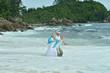 Portrait of happy elderly couple resting on beach