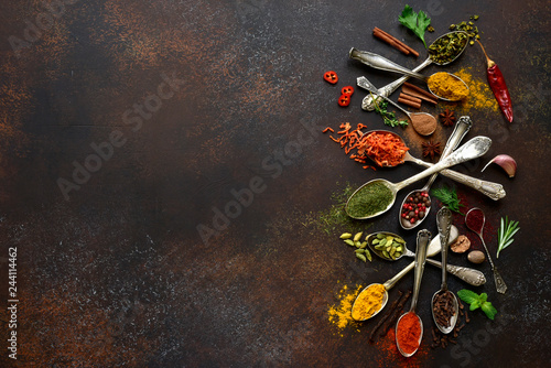 Fototapeta Assortment of natural spices on a vintage spoons.Top view with copy space. obraz