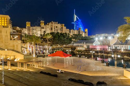Fotografie, Tablou Night view of Burj Al Arab (Tower of the Arabs) seen from Madinat Jumeirah in Du