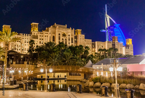 Photo  Night view of Burj Al Arab (Tower of the Arabs) seen from Madinat Jumeirah in Du