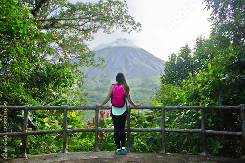 Female hiker looking out at the Arenal volcano in Costa Rica Canvas Print